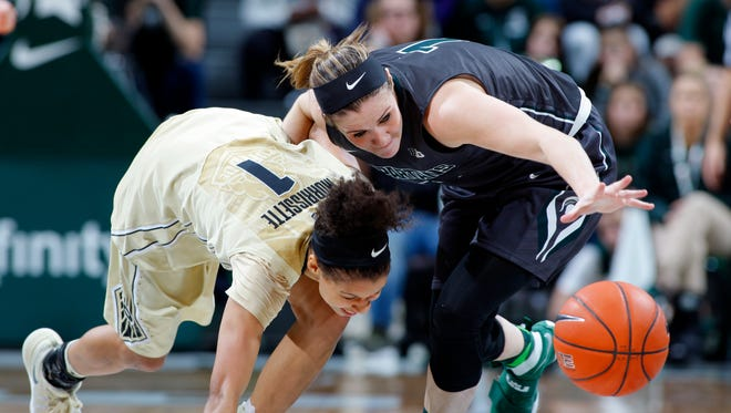 Michigan State's Tori Jankoska, right, steals the ball from Purdue's Ashley Morrisette Sunday in East Lansing, Mich. Michigan State fell 76-66.