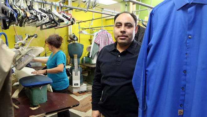 Owner Cruz Hernandez stands at Erie Cleaners in Blauvelt Feb. 25, 2015. They were fined $500 for an overdue inspection last year, a violation they corrected.