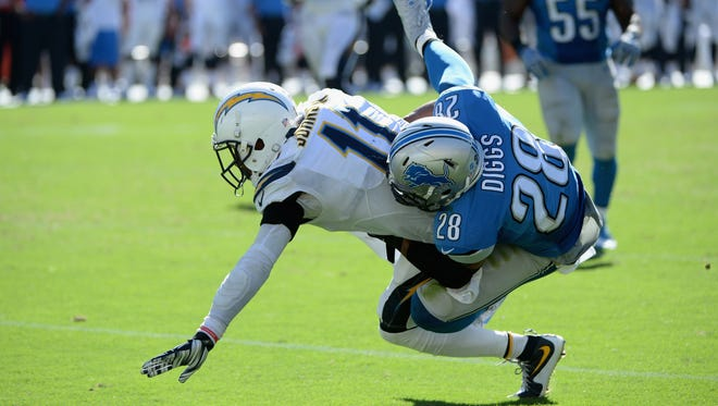 Wide receiver Steve Johnson of the San Diego Chargers is tackled by cornerback Quandre Diggs of the Detroit Lions on Sept. 13, 2015, in San Diego.