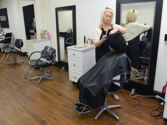 Amanda Morgan, owner, styles Morgan Jones' hair at Serendipity Salon and Spa located on Main Street in downtown Zanesville.