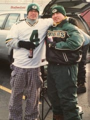 Eric Wetzel, left, and Jason Weiland pose for a photo while tailgating at a Green Bay Packers game on Dec. 22, 2002.