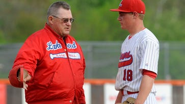 Lakewood coach Don Thorp talks to pitcher Quinn Chapman during a 2016 Division II tournament game.