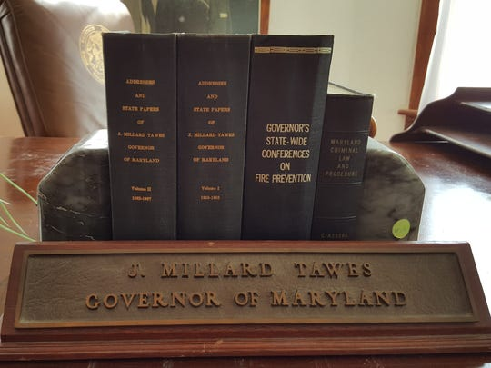 A few of the late J. Millard Tawes' favorite books sit with his nameplate at the front of the desk he used in Annapolis.