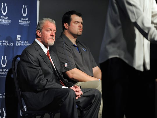 FILE - Colts owner Jim Irsay and GM Ryan Grigson listen as head coach Chuck Pagano thanks everyone for their support as he is welcomed back to his coaching duties Dec. 24, 2012.