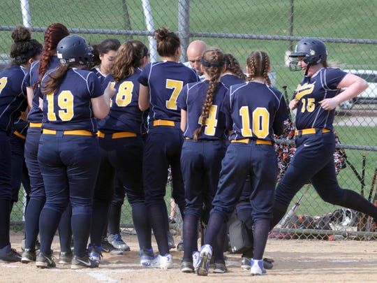 Paige Dauenheimer of Highland is congratulated by her teammates as she crosses home plate after hitting the first of her two home runs during a varsity softball game against Marlboro at Marlboro High School April 17, 2017. Dauenheimer's home runs accounted for all of Highland's scoring as Marlboro won the game 10-3.