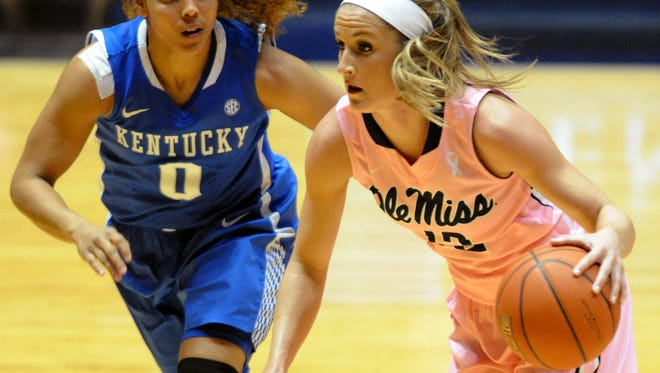 """Mississippi guard Gracie Frizzell (12) drives against Kentucky guard Jennifer O'Neill (0) During the NCAA basketball game at the C.M. """"Tad"""" Smith Coliseum in Oxford, Miss., on Monday, Feb. 23, 2015. (AP Photo/Oxford Eagle, Bruce Newman)  NO SALES  MAGS OUT"""