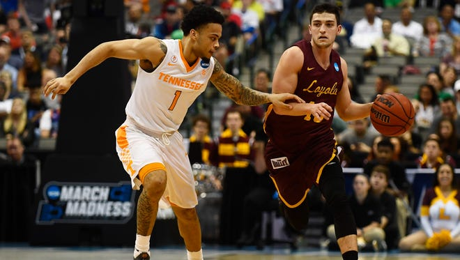 Tennessee guard Lamonte Turner (1) defends Loyola-Chicago guard Clayton Custer (13) in the second round of the NCAA Tournament in Dallas, TX on Saturday, March 17, 2018.  Saturday, March 17, 2018.