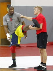 Enock Francois, left, works out with four-time NCAA Division I national champion Kyle Dake during a Cornell University wrestling practice Jan. 21 at the Friedman Wrestling Center in Ithaca.