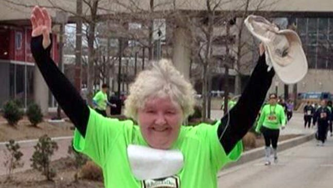 Ginny Yingst finishes her first 5K race on St. Patrick's Day in 2014 in Baltimore.