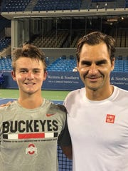J.J. Wolf and tennis legend Roger Federer pose for