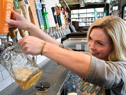Alison Woods pours a beer at the Von Elrod's Beer Garden & Sausage House that will soon open in the Germantown neighborhood.photographed Friday, Sept. 29, 2017 in Nashville, Tenn.