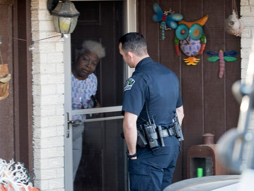Authorities investigate the scene in East Austin, TX,