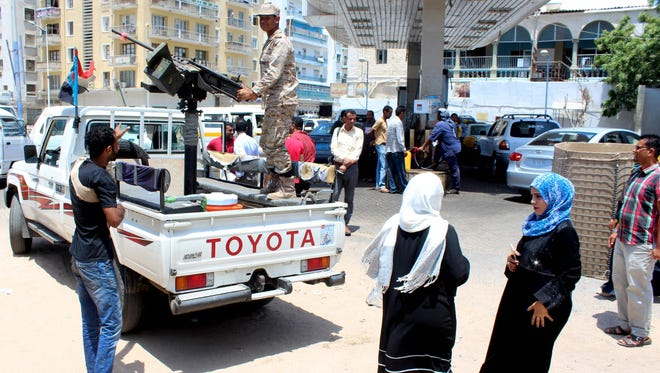 Forces loyal to the Saudi-backed Yemeni government stand guard in Aden on April 11, 2016.