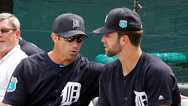 Mar 14, 2016; Lakeland, FL, USA; Detroit Tigers manager Brad Ausmus and pitcher Daniel Norris (right) talk during the third inning of a spring training baseball game against the New York Mets at Joker Marchant Stadium.