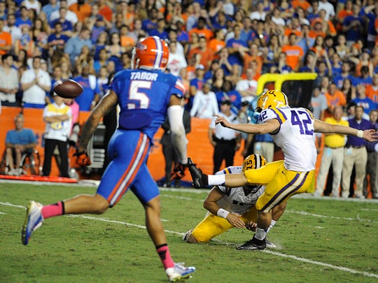 LSU kicker Colby Delahoussaye (42) kicks the winning field goal with Florida's Jalen Tabor unable to stop the play in LSU's 30-27 win Saturday.