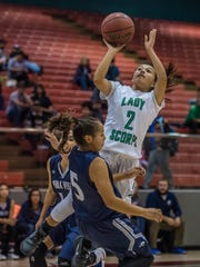 Farmington's Celeste Coolidge shoots over Piedra Vista's Alexis Long on Thursday at the Chieftain Pit in Shiprock.