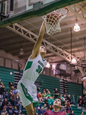 Farmington's Jacob Browns puts down a dunk against Shiprock on Thursday at Scorpion Gym.