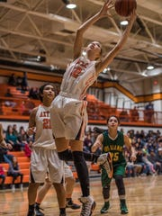 Aztec's Reigan Weaver grabs a rebound against Los Alamos on Friday at Lillywhite Gym in Aztec.