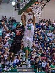 Farmington's Kody Becenti, right attacks the basket against Gallup's Zakani Fields on Thursday at Scorpion Gym.