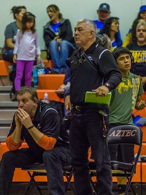 Herb Stinson, right, coaches during a match at the Aztec Tiger Duals on Jan. 23, 2016, at Lillywhite Gym in Aztec.