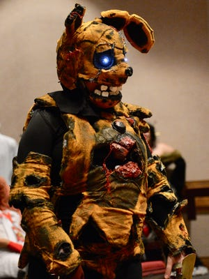 A cosplayer shows off their costume at the Animania Cosplay Contest Saturday, June 24, 2017, at the MPEC.