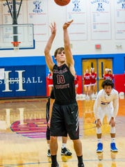 Cheatham County's Johnathan Mayberry shoots a free throw during the Cubs' loss to Harpeth.