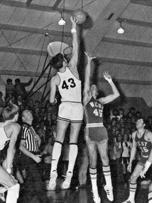 Steve Boyce jumping center during a high school game.