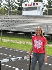 West Branch senior Paige Miller poses on the track