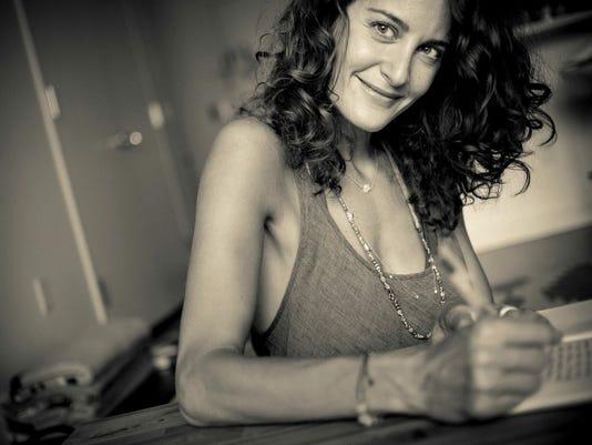 Elena Writing.jpg