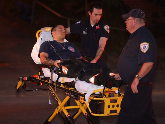 A firefighter is removed from the scene as the Yonkers