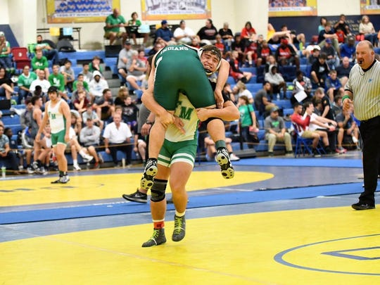 Fort Myers High 195-pound senior wrestlers Matt McQuinn