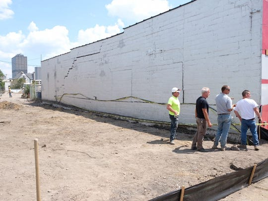 A large crack in the side of the UFO Factory was caused