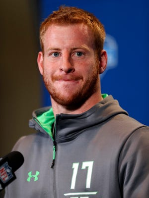 North Dakota State Bisons quarterback Carson Wentz speaks to the media during the 2016 NFL Scouting Combine at Lucas Oil Stadium.