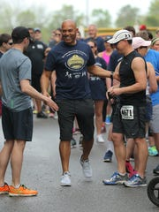 Mariano Rivera greets runners at a 5K in Garnet Valley, Pennsylvania.
