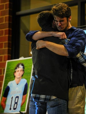 Corey Hoffman, left, and Corey Gamble comfort each other at a vigil for their friend Jim Cheek at Centennial High School on Friday, Nov. 25, 2016, in Franklin. Cheek, who was a senior and on the football team at Centennial, was killed in a car crash Nov. 21.
