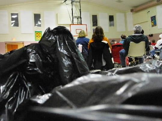 Garbage bags filled with blankets, food and other supplies wait to be handed to the homeless in Lebanon County on Wednesday night. About 70 volunteers signed up for the homeless count and received a brief training at the Salvation Army before heading out from 9 p.m. to midnight.