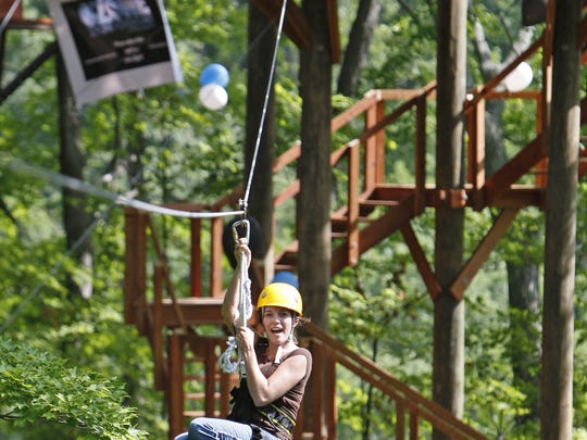 Try out the Ozone Zipline together. (Outdoors reporter