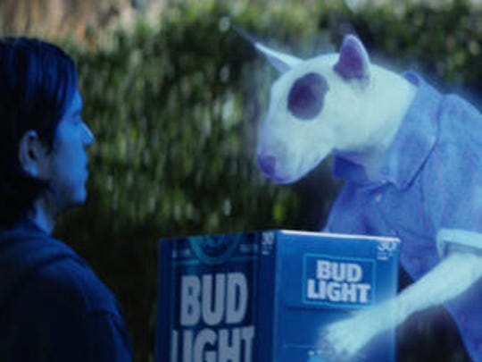 """This photo provided by Bud Light shows a scene from the company's """"Ghost Spuds,"""" spot for Super Bowl 51, between the New England Patriots and Atlanta Falcons, Sunday, Feb. 5, 2017. Bud Light is re-introducing the brand's '80s pop culture icon and man's best friend, Spuds MacKenzie."""