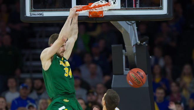 North Dakota State Bison forward Chris Kading (34) dunks in the second half against the South Dakota State Jackrabbits during the championship game of the Summit League Conference at Denny Sanford Premier Center.