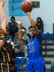 Murrah's Nya Irvin (23) shoots against Starkville Thursday
