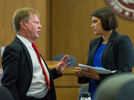 Davis Ruark, left, speaks with expert witness Raman Sandhu-Kirmer during the high-profile Tai Chan murder trial in 2016.