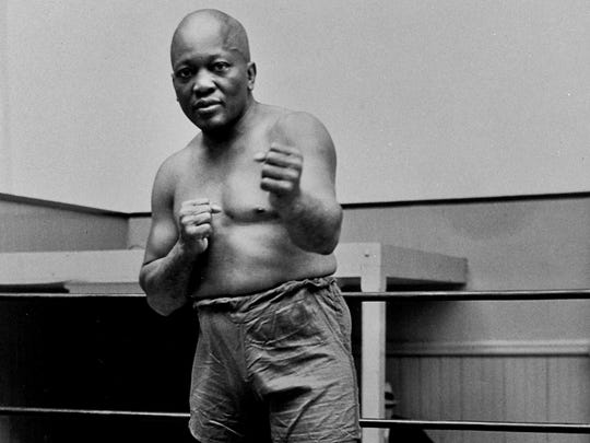 In this 1932 file photo, boxer Jack Johnson, the first