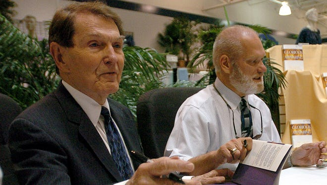 In an April 4, 2004 file photo, co-authors Tim Lahaye, left, and Jerry B. Jenkins sign copies of their book Glorious Appearing in Bossier City, La.