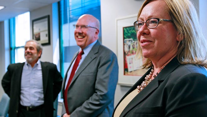 "Carrie Wall, newly appointed president and chief executive officer of the YMCA of Metropolitan Milwaukee (right), Richard ""Rick"" Schmidt as board chair, (center) and Richard Canter, the outgoing board chairman, left are pictured at the downtown office at 161 W. Wisconsin Ave., on Thursday."