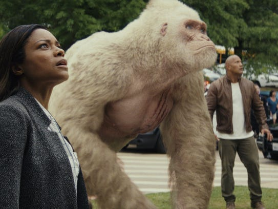 "Naomie Harris and Dwayne Johnson star in ""Rampage."""