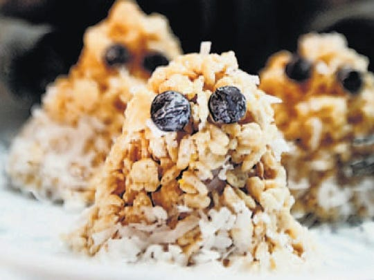 Shape the traditional Ricke Krispies Treats recipe into ghost shapes and attach chocolate chips for eyes.