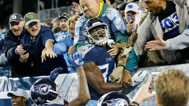 Tennessee Titans wide receiver Corey Davis (84) celebrates after scoring a touchdown on an 11-yard pass against the New York Jets in the fourth quarter of an NFL football game Sunday, Dec. 2, 2018, in Nashville, Tenn. The touchdown gave the Titans a 26-22 win. (AP Photo/James Kenney)