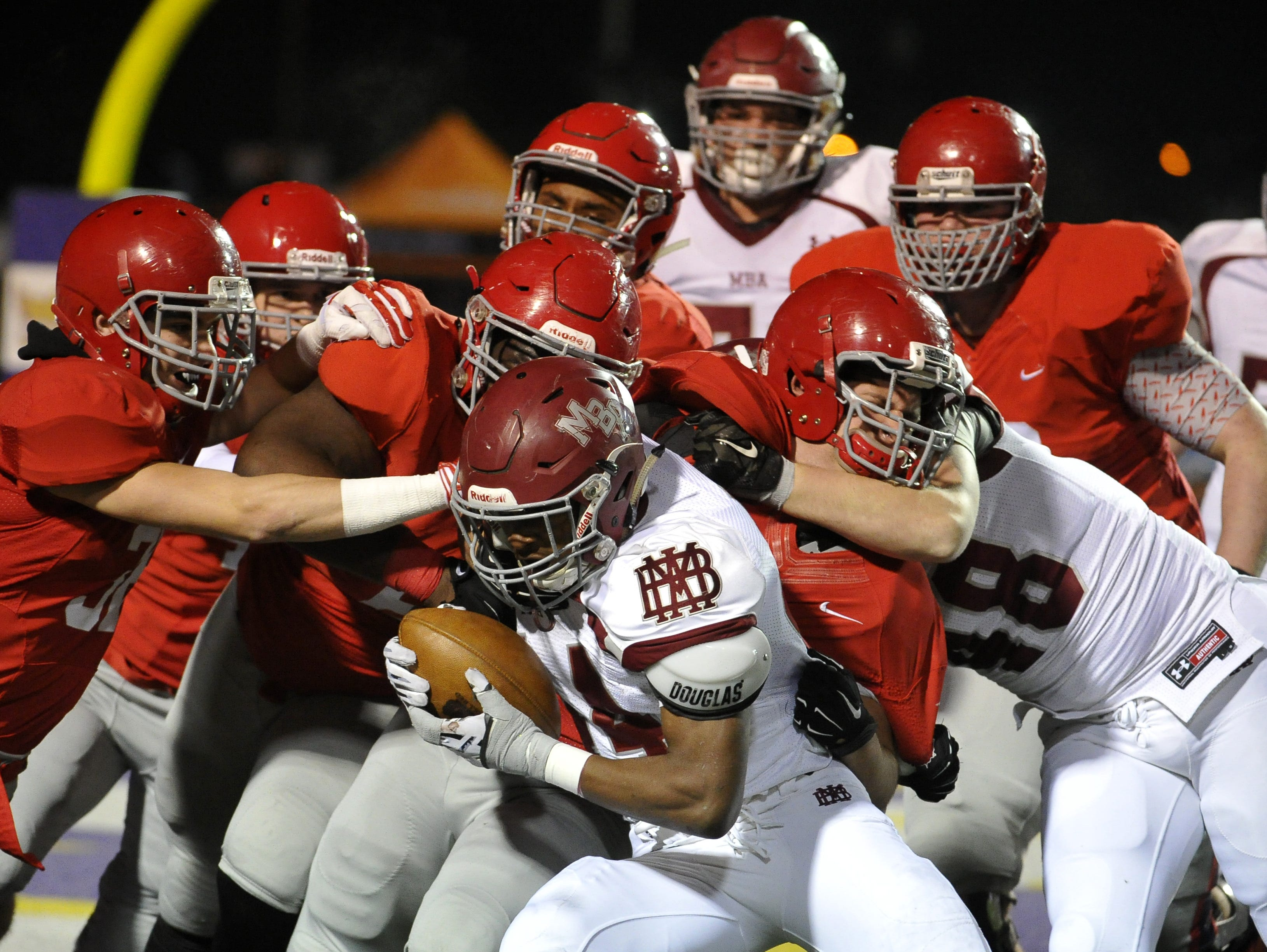 MBA's Ty Chandler drags a horde of Brentwood Academy tacklers with him during the DII-AA state title game.