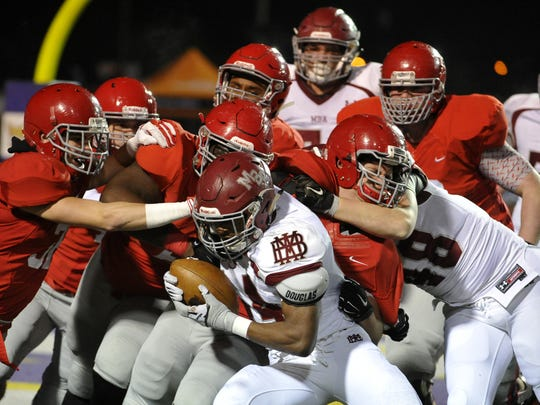 MBA's Ty Chandler drags a horde of Brentwood Academy