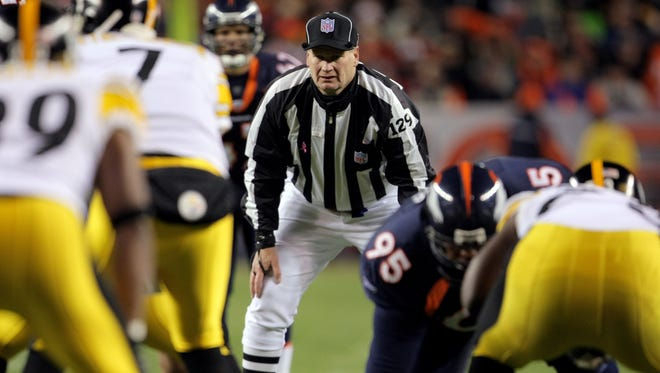 Umpire Bill Schuster oversees the action as the Denver Broncos face the Pittsburgh Steelers on Oct. 21, 2007 in Denver, Colorado.